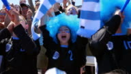 MS PAN Crowd of sports fans standing and cheering during soccer match in stadium