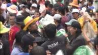 A crowd of Thailanders race to pass sandbags as floods threaten