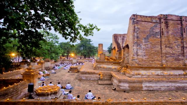 Crowd Praying at temple ruin Time Lapse