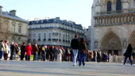 Crowd Queing at Notre Dame Cathedral Paris France