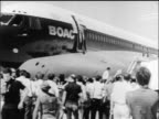 B/W 1970 crowd standing by parked airliner during PLO hijacking / Jordan / newsreel