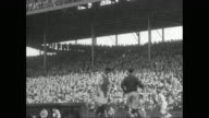 WS PAN Crowd stands and cheers watching baseball game in stadium / United States