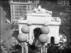 AERIAL crowd under temporary Victory Arch on Fifth Avenue at end of World War I / NYC