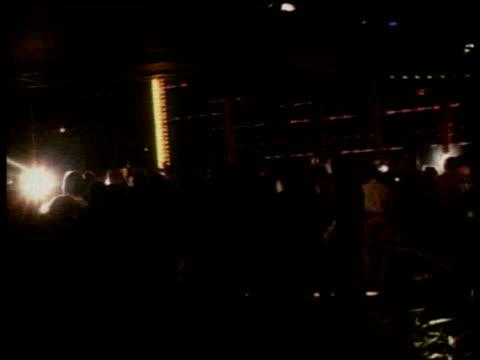 Crowd waiting outside Studio 54/ WS Flashing lights inside club/ MS Club goers/ MS Shirtless men dancing together/ New York New York