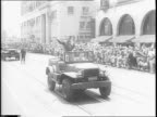 Crowd waits for General George Patton Jr to speak / General Patton riding in car / General Patton in car waves / General Patton waving / General...