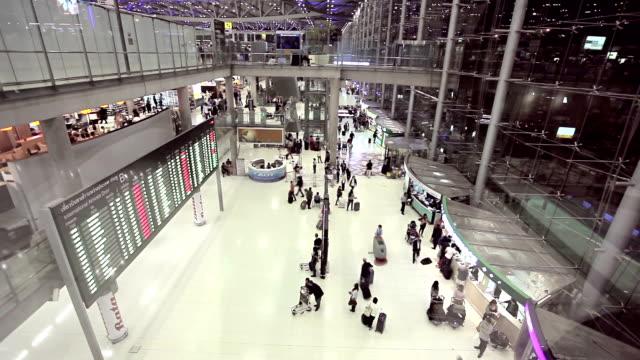 Crowd walking at airport, Bangkok, Thailand.