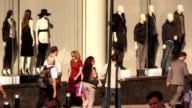 Crowd Walking by Mannequins in New York City