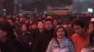 WS Crowd walking through Nanjing Road at dusk/ Shanghai, China