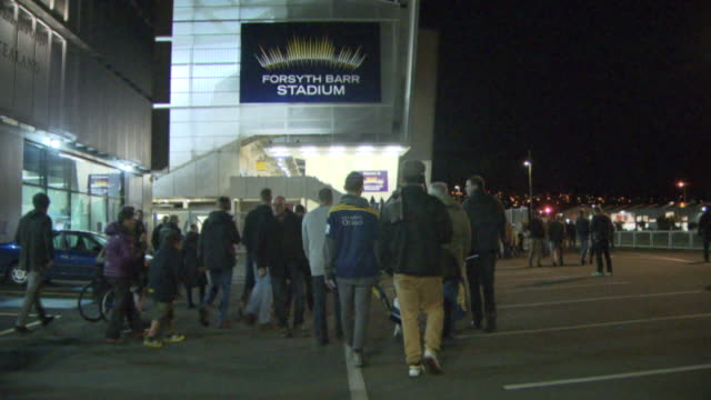 Crowd walking to Forsyth Barr Stadium in Dunedin for Super Rugby match between Highlanders and Crusaders and handheld electronic device scanning...