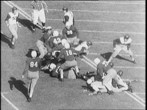 Crowd watching game / Oregon vs USC / Jimmy Newquist passes to teammate / Curtis Meechum passes ball to Tommy Roblin scores a touchdown for Webfoots...