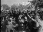 PAN crowd waving cheering giving victory sign outdoors / liberation of French Tunis