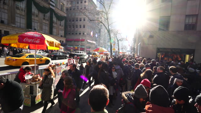 Crowded 5th Avenue between Rockefeller Center and Saks Fifth Avenue at Midtown Manhattan 5th Avenue in Winter Holidays 2016.