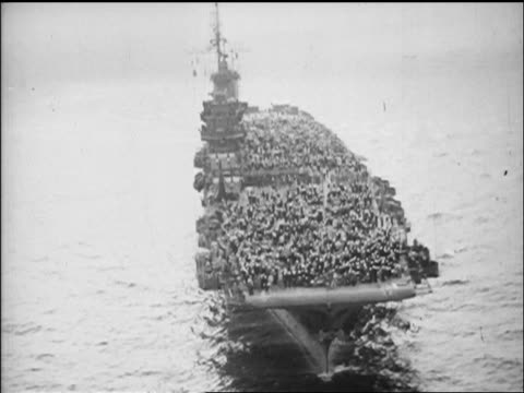 AERIAL crowded aircraft carrier Saratoga on ocean after VJ Day / newsreel