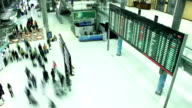 Crowded airport time-lapse, airport travelers people.