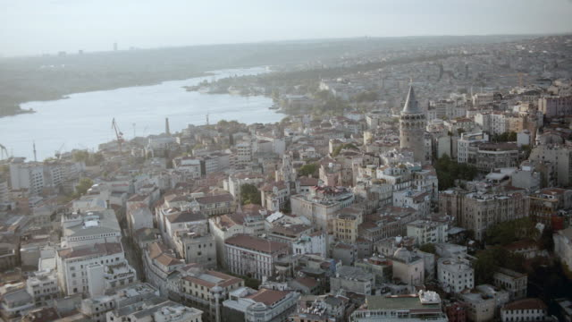 AERIAL Crowded cityscape overlooking the Bosphorus Strait / Istanbul, Turkey