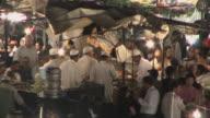 MS HA Crowded market in Djemaa el Fna square, Marrakech, Morocco