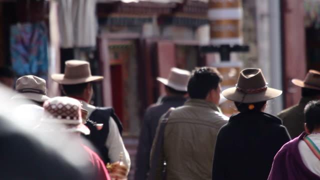 Crowded people praying and walking at Tibet