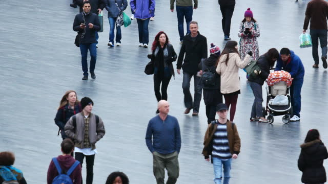 Crowded people & tourists at Tower Bridge, London
