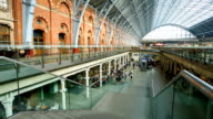 Crowded people train station, King's Cross St. Pancras in London, time lapse