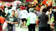 HD: Crowded people walking and shopping in the market, Hong Kong