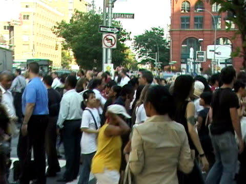Crowds and traffic at Broadway/Houston in SoHo right after blackout people attempting to direct traffic emergency vehicles crowds moving