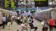 TL, MS Crowds and trains on Churchgate railway station platform / Mumbai, India