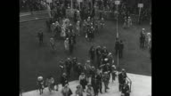 WS crowds at Ascot Racecourse prior to running of the Ascot Stakes / racing fans enter enclosure / montage royal carriage bearing King George VI and...