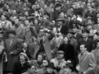 Crowds cheer and clap at an American football game at Wembley Stadium