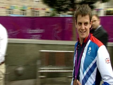 Crowds cheer and greet the Olympic medallists Alistair and Jonathan Brownlee at a homecoming reception in Millennium Square Leeds