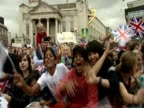 Crowds cheering waiting for Olympic athletes at homecoming in Leeds