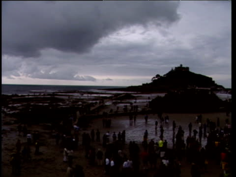 Crowds in darkness watching solar eclipse at Saint Michael's Mount Total Eclipse in the UK 11 Aug 99