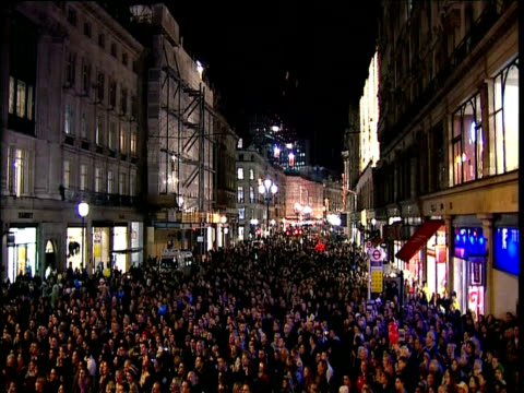 Crowds in Oxford Street celebrate Christmas lights coming on