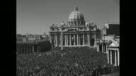 VWS crowds in St Peter's Square with Basilica in BG / Nice shot of Basilica dome PAN down to crowd / VS crowds in St Peter's Square with Basilica in...