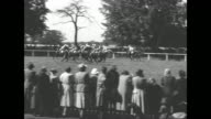 WS crowds in stands at Ascot Racecourse site of the Ascot Gold Cup horse race / the royal party looks on from their box Queen Elizabeth looks through...