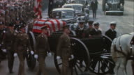 TS Crowds lining the streets to see President Franklin D Roosevelt's casket the caisson drawn by white horses and with police and military escort /...