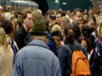 Crowds of commuters board and alight underground trains on busy U-Bahn Munich
