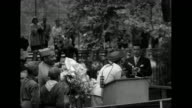 VS crowds of mostly AfricanAmericans waiting for arrival of singer Josephine Baker on 'Josephine Baker Day' / MS Baker on stage behind podium is...