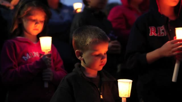 Crowds of people amass at Garvey Park in Dorchester Massachusetts in a candlelight vigil for 8 year old Martin Richard who was killed at the finish...