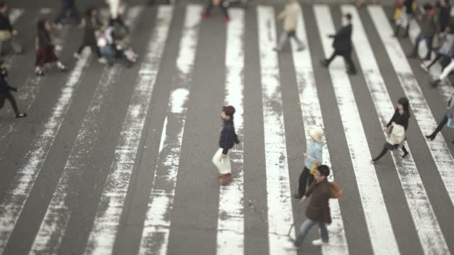 Crowds of people crossing street / Osaka, Japan