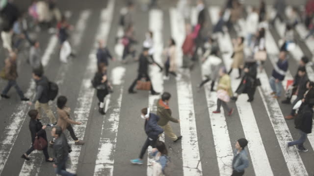 Crowds of people crossing street / Osaka, Japan