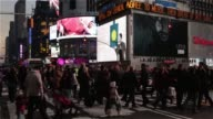 Crowds of visitors walk through Time Square in New York City New York during the holiday shopping season on December 14th 2015 Photographer Ara Ayer...