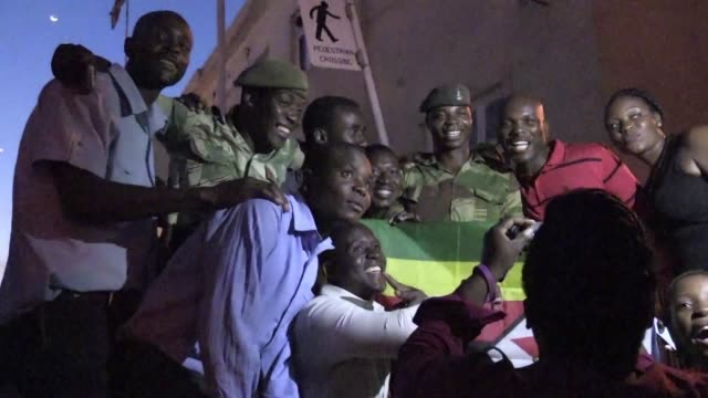 Crowds of Zimbabweans celebrating the resignation of President Robert Mugabe on Tuesday appeared to thank soldiers after the army played a key role...