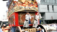 Crowds packed the city center streets here for the spectacular sights and sounds of the Yamahoko Junko grand procession at the annual Gion Festival...