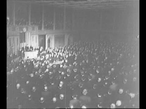 Crowds stand in front of US Capitol in background / crowds behind rope barricade/ montage US President Franklin Roosevelt addresses Congress on the...