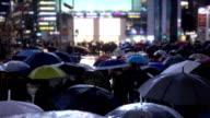 Crowds walk across a crossroads. Slow Motion