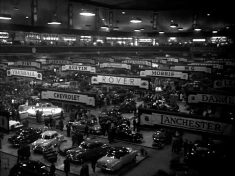 Crowds walk around the stands at the Earls Court motor show