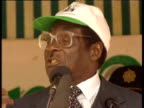 Crowds watch as President Mugabe declares his antiBritish stance at rally 2000s