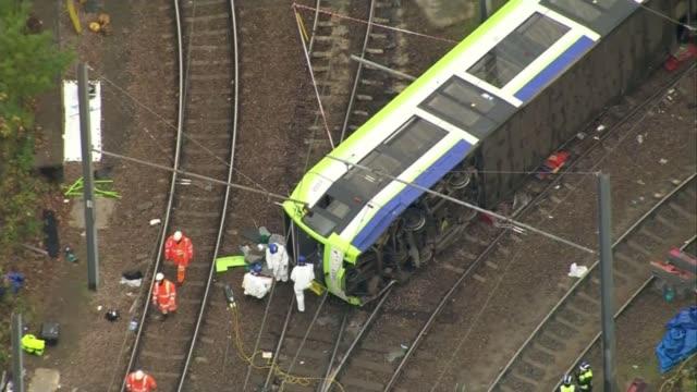 First victim named ENGLAND London Croydon Overturned tram and investigators at scene