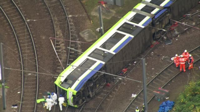 First victim named EXT **Dale interview overlaid SOT** Overturned tram and investigators at scene