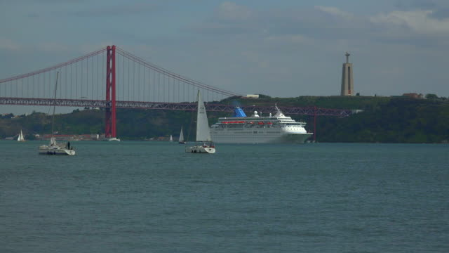 Cruise ship on Tagus River near the Ponte 25 de Abril, Belem, Lisbon, Portugal